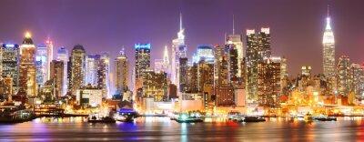 Fototapet Manhattan skyline på natten.