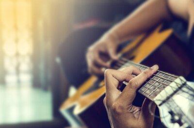 Fototapet människohand i klassisk gitarr