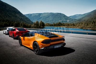 Fototapet Miland, Norway. 04.06.2016: Yellow Lamborghini Huracan, Red Ferrari f12m and white Mclaren 650s