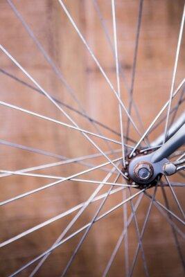Fototapet Närbild av ekrarna i hjulet för en cykel