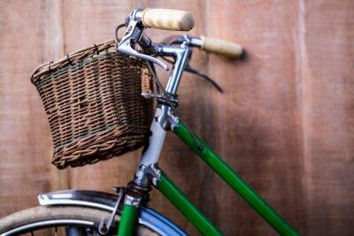 Fototapet Närbild av en gammal grön cykel