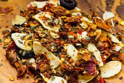 Fototapet Närbild färgade kryddor för pasta mix
