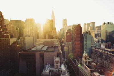 Fototapet New York City Manhattan skyline utsikt vid solsken.