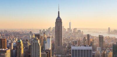 Fototapet New York Manhattans skyline i solnedgången.