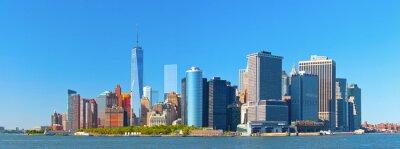 Fototapet New York nedre Manhattan finansiella wall street distrikts byggnader horisont på en vacker sommardag med blå himmel