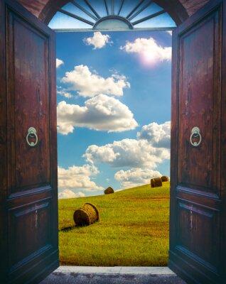 Fototapet Öppna dörren och landskap