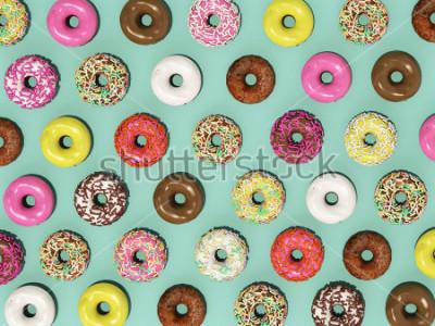 Fototapet Överbild Ställ färgglada munkar på munstycke på grön bakgrund, vilket ger 3d Donuts