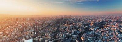Fototapet Panorama över Paris på solnedgången