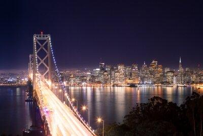 Fototapet Panorama över San Francisco Bay Bridge e di notte