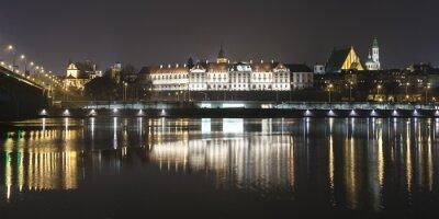 Fototapet Panoramautsikt över Warszawa vattnet på natten.