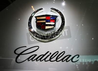 Fototapet PARIS - 14 oktober: En General Motors Co. (GM) Cadillac logotype är företagets volt under Paris Motor Show 2010 på Porte de Versailles, den 14 oktober, 2010 i Paris, Frankrike