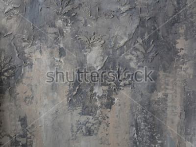 Fototapet prydnad på en grå betongvägg