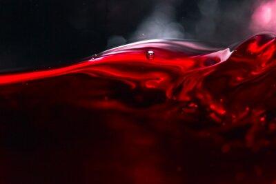 Fototapet Rött vin på svart bakgrund