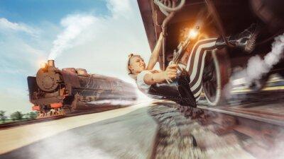 Fototapet Sexig kvinna med pistolen försöker stoppa tåget.