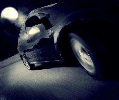 Fototapet Sidovy av svart bil i sin tur