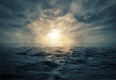 Fototapet Solnedgång på stormigt hav