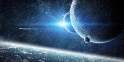 Fototapet Soluppgång över jorden i rymden
