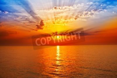 Fototapet soluppgången i havet