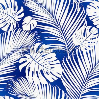 Fototapet Sömlös upprepande mönster med vita silhuetter av palmträdblad på blå bakgrund.
