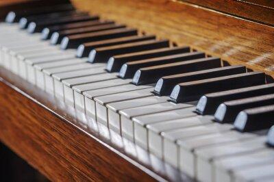 Fototapet Stäng av piano tangentbord med begränsad skärpedjup