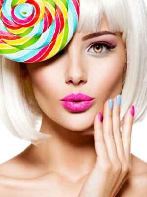Fototapet Surprised face of a pretty woman  with multicolor nails and pink lips