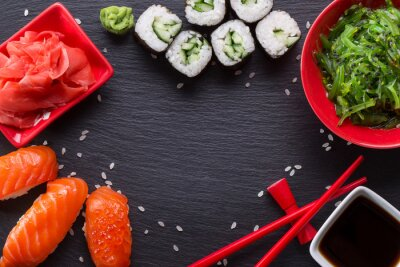 Fototapet sushi och rullar på en skiffer bord
