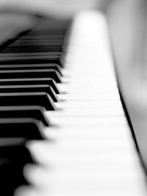Fototapet Svart piano närbild oskärpa bakgrund och förgrund.