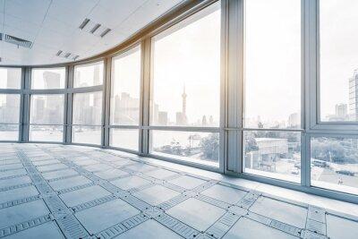 Fototapet tomt kontorsrum i moderna kontorsbyggnader i soluppgång
