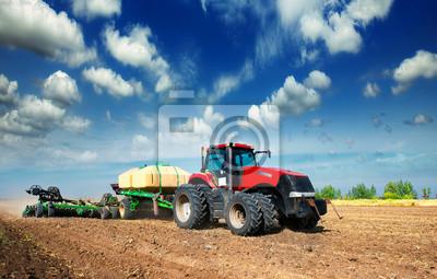 Fototapet traktor i ett fält