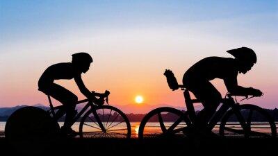 Fototapet Triathlon på stranden kvällstid