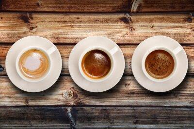 Fototapet tris di caffè su fondo legno