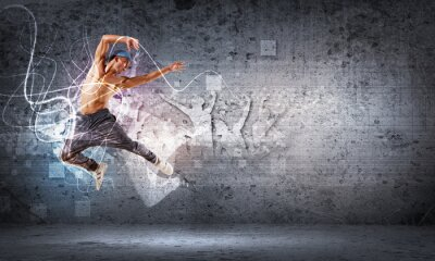 Fototapet ung man dansar hip hop med färglinjer