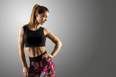Fototapet Vacker fitness kvinna stående