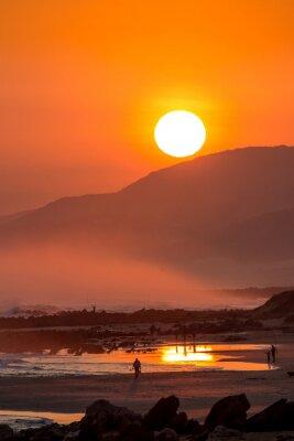 Fototapet Vacker solnedgång med stora runda Sun