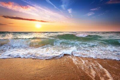 Fototapet Vacker solnedgång över havet.