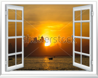Fototapet vacker solnedgång vid havsutsikten från fönstret med gardiner öppna
