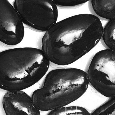 Fototapet våta svarta stenar