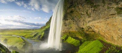 Fototapet vattenfall faller från himlen i Island