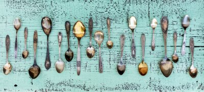 Fototapet Vintage cutlery - spoons, forks and knives on an old wooden background.