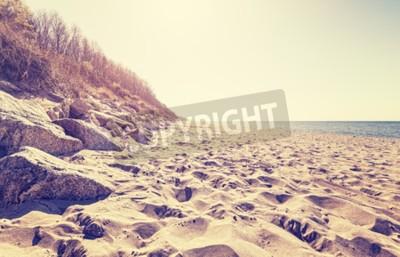 Fototapet Vintage tonade bilden av en strand i solnedgången.
