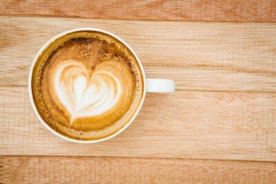 Fototapet Vy över ett hjärta bestående av kaffe