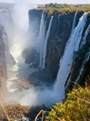 Fototapet Vy över Victoria Falls från marken. Mosi-oa-Tunya nationalpark. och världsarv. Zambiya. Zimbabwe. En utmärkt illustration.