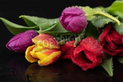 Fototapet Wet tulip flower on a dark wet table. A bouquet of flowers with water. Dark background.