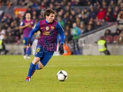 Fototapet BARCELONA - Lionel Messi i aktion under spanska cupen matchen mellan FC Barcelona och Valencia CF, slutresultatet 2-0, i fotbollsstadion Camp Nou, Barcelona, Spanien