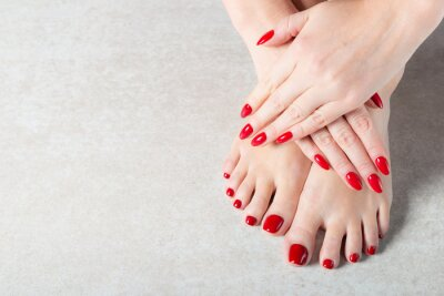 Fototapet Young lady is showing her red manicure nails
