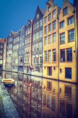 Väggdekor Amsterdam under våren. Husen är längs kanalerna.