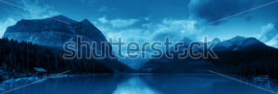 Väggdekor Banff national park Lake Louise sunrise panorama with mountains and forest in Canada.