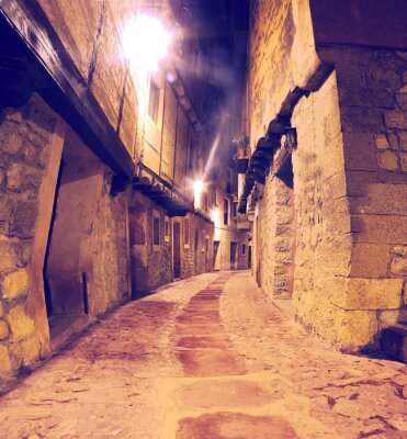 Väggdekor Calle de pueblo al Anochecer con Faroles