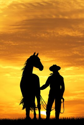 Väggdekor cowboy med häst på solnedgången
