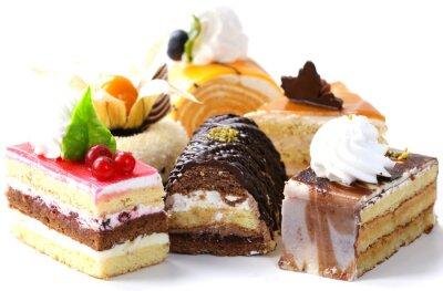 Väggdekor Diverse olika mini kakor med grädde, choklad och bär